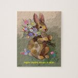"easter bunny and eggs jigsaw puzzle<br><div class=""desc"">A jigsaw puzzle to personalize for a child&#39;s Easter basket. A cute calico rabbit carrying a bouquet of brightly colored eggs. Fun to make the puzzle over and over. Comes with or without a matching tin container.</div>"