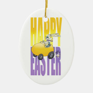 Easter bunny driving an egg. ceramic ornament