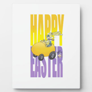 Easter bunny driving an egg. plaque