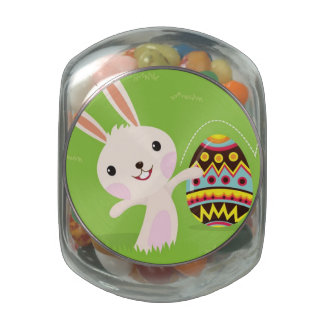 Easter bunny playful with painted eggs glass jar