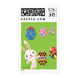 Easter bunny playful with painted eggs postage