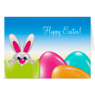 easter bunny with colorful eggs and greetings card
