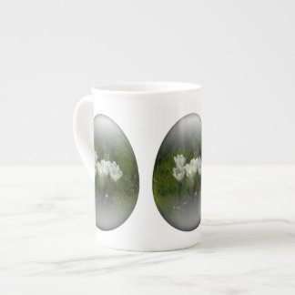 easter egg with white tulips tea cup