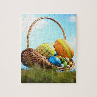 Easter eggs in basket on grass, ground view puzzle