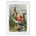 EasterBunnies en un barco con los huevos coloreado Tarjetón