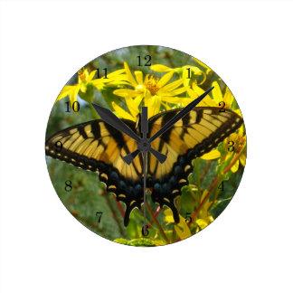 Eastern Tiger Swallowtail on Yellow Daisies Round Clock