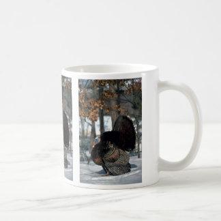 Eastern wild turkey, big gobbler strutting in snow coffee mug