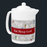 """Eat Sleep Golf Teapot<br><div class=""""desc"""">Medium white Porcelain teapot with an image, on both sides, of white golf balls and red, yellow, blue and green tees. Optional red ribbon and text. See matching candy jar, espresso cup, flask, mug, pitcher, paper plate, shot glass and coasters. See the entire Father's Day Teapot collection in the FOOD/BEV...</div>"""