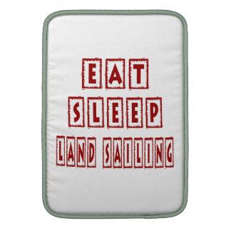 Eat Sleep Land Sailing MacBook Sleeves