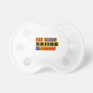 EAT SLEEP SKIING AND REPEAT PACIFIER