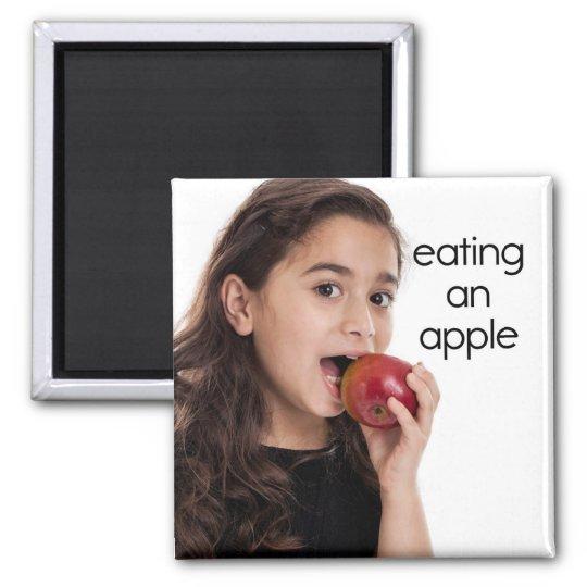 Eating an Apple Refrigerator Magnet