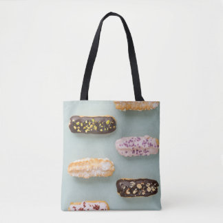 Eclairs with ganache and toppings tote bag
