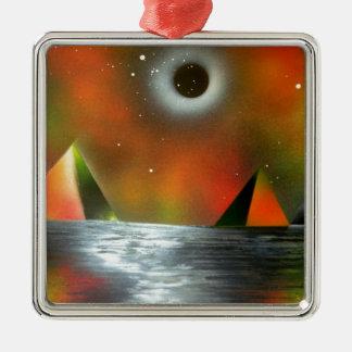 Eclipse sobre las pirámides adorno cuadrado plateado