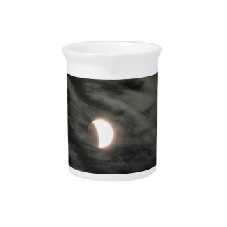 Eclipsing Supermoon among Clouds Pitcher