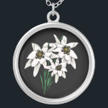 """Edelweiss necklace<br><div class=""""desc"""">Pretty necklace with graphic artwork of edelweiss flowers,  on a black background. Very pretty flowers,  with a traditional Alpine look,  makes a unique piece of jewelry for yourself or as a gift.</div>"""