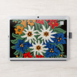 """Edelweiss Swiss Alpine Flower HP Laptop Skin<br><div class=""""desc"""">An image of a floral pattern with a needlework look of Edelweiss white Alpine flowers of Europe on your product. Blue,  red,  yellow,  and white colors. Leontopodium alpinum of Switzerland,  Germany,  and Austria.</div>"""