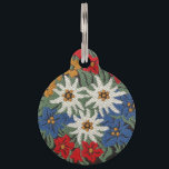 """Edelweiss Swiss Alpine Flower Pet Tag<br><div class=""""desc"""">An image of a floral pattern with a needlework look of Edelweiss white Alpine flowers of Europe on your product. Blue,  red,  yellow,  and white colors. Leontopodium alpinum of Switzerland,  Germany,  and Austria.</div>"""