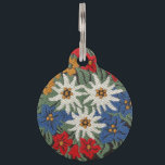 "Edelweiss Swiss Alpine Flower Pet Tag<br><div class=""desc"">An image of a floral pattern with a needlework look of Edelweiss white Alpine flowers of Europe on your product. Blue,  red,  yellow,  and white colors. Leontopodium alpinum of Switzerland,  Germany,  and Austria.</div>"