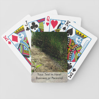 Edge of pond reed and single plant bicycle playing cards