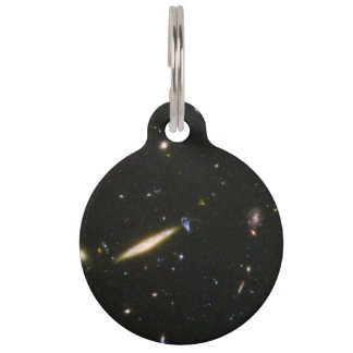 Edge-On Spiral Galaxy Collides With Small Blue Gal Pet Nametag