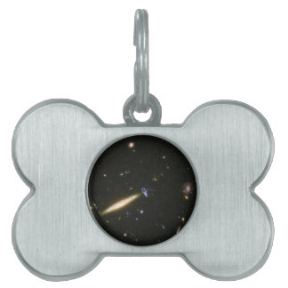 Edge-On Spiral Galaxy Collides With Small Blue Gal Pet Name Tag