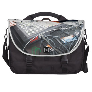 EDM DJ mixing music at an underground show Commuter Bags