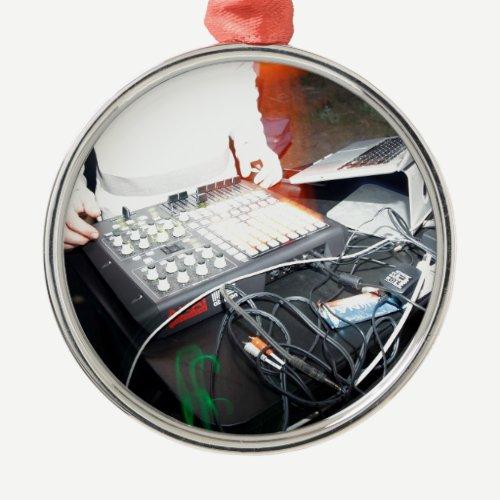 EDM DJ mixing music at an underground show Metal Ornament