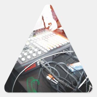 EDM DJ mixing music at an underground show Triangle Sticker