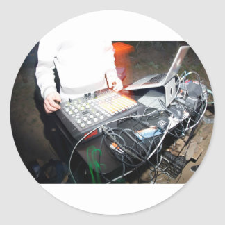EDM DJ mixing music at an underground show Classic Round Sticker