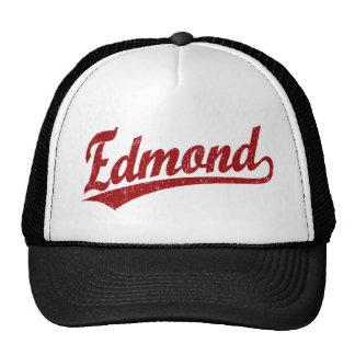 Edmond script logo in red trucker hat