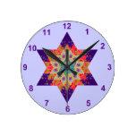 Edredón de la estrella en púrpura y naranja reloj