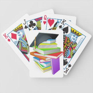 Education book pile graduation hat concept card deck