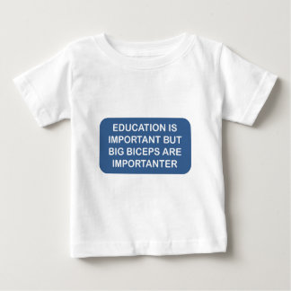 Education is import Big biceps are importanter Baby T-Shirt