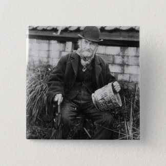 Edward Bingham holding one of his Castle Pinback Button