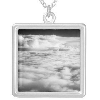 Eerie cloudscape at sunrise. 2 silver plated necklace