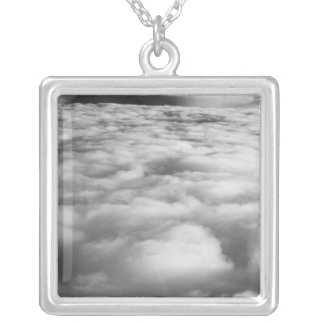 Eerie cloudscape at sunrise. silver plated necklace