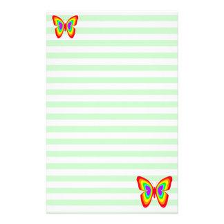 Efectos de escritorio de las mariposas del arco ir papelería