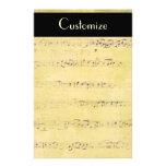 Efectos de escritorio de las notas musicales de la papeleria de diseño