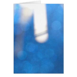Efectos luminosos blancos azules tarjeta de felicitación
