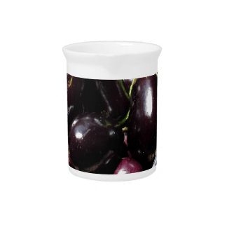 Eggplants in box on white background pitcher