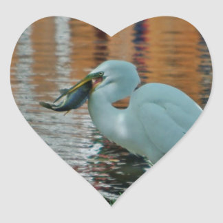 Egret and its catch heart sticker