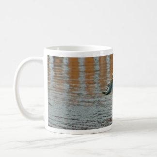 Egret and its catch classic white coffee mug