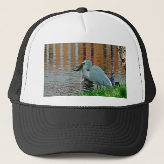 Egret and its catch trucker hat