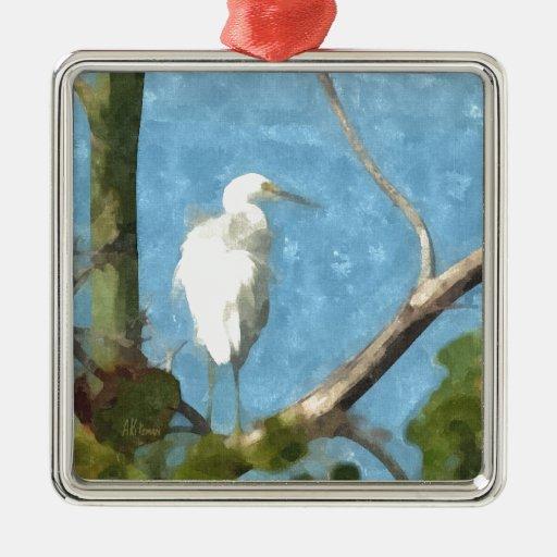 Egret nevado en árbol adorno navideño cuadrado de metal