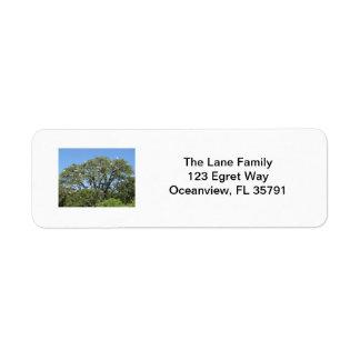 Egrets en una etiqueta del árbol etiqueta de remite