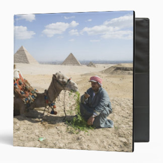 Egypt, Giza. Native man feeds his camel in 3 Ring Binder