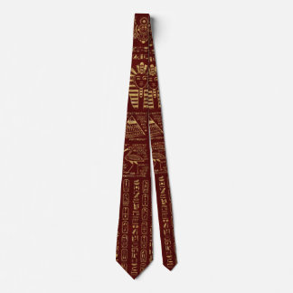 Egyptian hieroglyphs and symbols on red leather neck tie