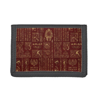 Egyptian hieroglyphs and symbols on red leather trifold wallet
