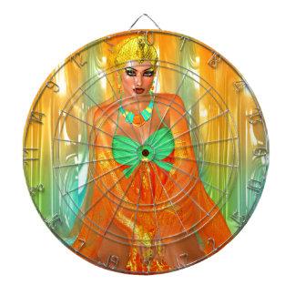 Egyptian princess in orange silks and emerald gree dartboard with darts