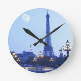 Eiffel Tower at Dusk Round Wall Clocks